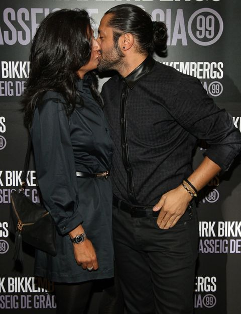 Kiss, Interaction, Romance, Fashion accessory, Logo, Black, Watch, Black hair, Love, Belt,