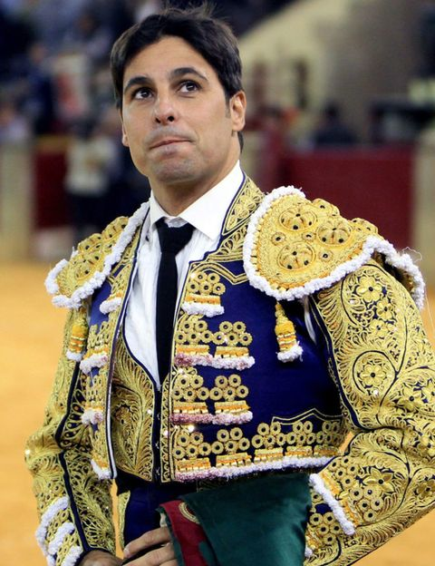 Dress shirt, Matador, Collar, Tradition, Blazer, Tie, Fur, Fashion design, Bullfighting, Costume design,