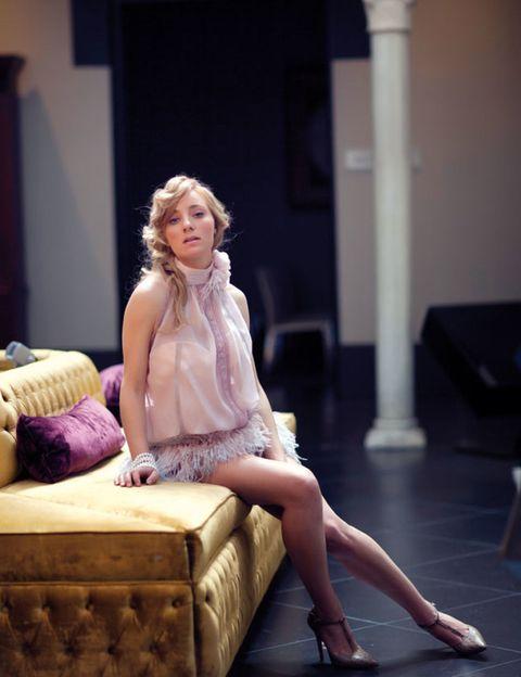 Sitting, Human leg, Dress, Beauty, Fashion, Foot, Street fashion, Blond, Ankle, Pillow,