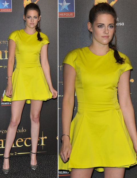 Yellow, Hairstyle, Sleeve, Dress, Shoulder, Joint, Standing, One-piece garment, Waist, Formal wear,