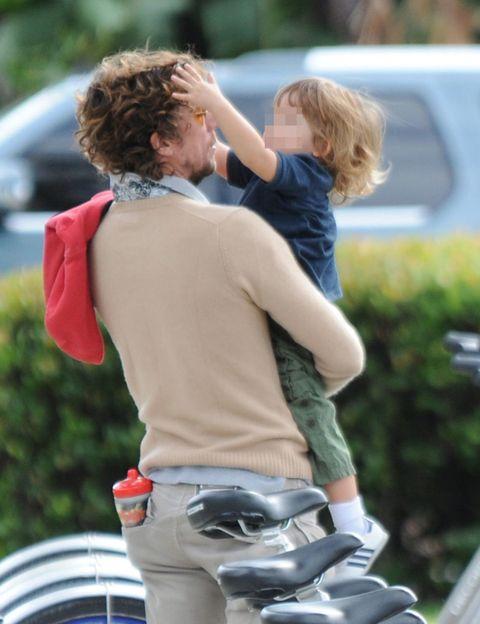 Hair, Mammal, Interaction, Blond, Bicycle, Bicycle handlebar, Back, Bicycle part, Love, Belt,