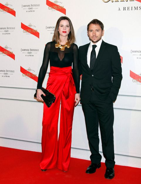 Trousers, Red, Coat, Shirt, Outerwear, Formal wear, Flooring, Style, Dress, Suit,