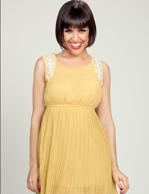 Dress, Hairstyle, Yellow, Sleeve, Shoulder, Joint, Bangs, One-piece garment, Formal wear, Waist,