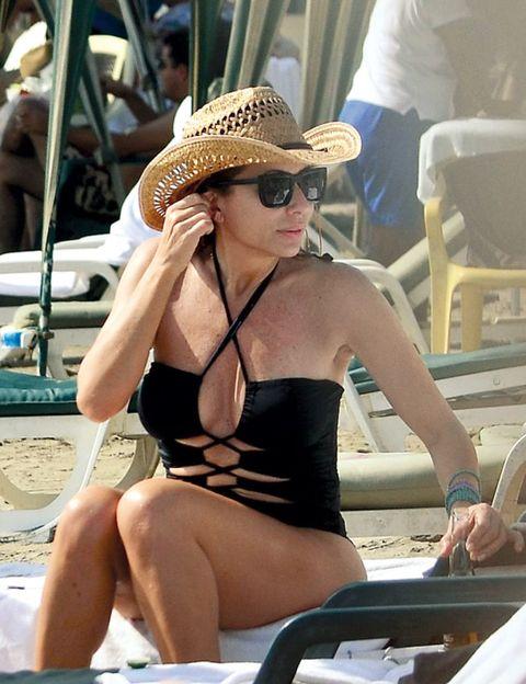 Eyewear, Glasses, Hat, Sitting, Brassiere, Summer, Sunglasses, Sun hat, Fashion accessory, Headgear,