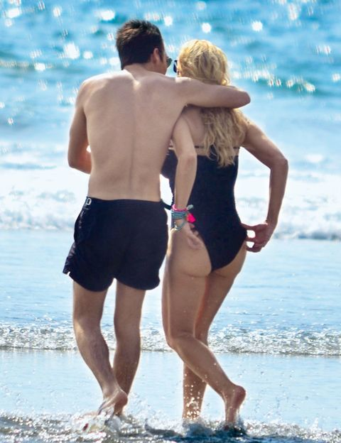 Clothing, Arm, Leg, Fun, Human body, People on beach, Standing, Mammal, People in nature, Summer,