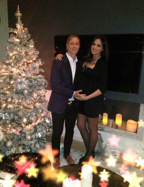 Smile, Event, Trousers, Christmas decoration, Photograph, Christmas tree, Holiday, Interior design, Christmas ornament, Christmas eve,
