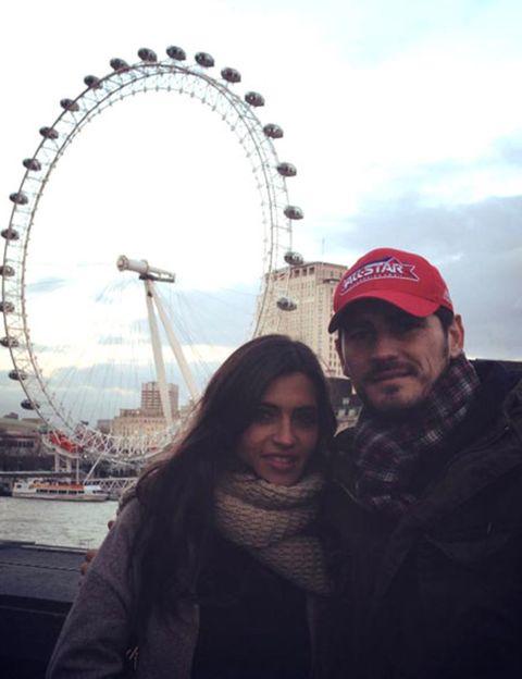 Nose, Ferris wheel, Cap, Mouth, Sky, Photograph, Tourism, Landmark, Amusement ride, Urban area,