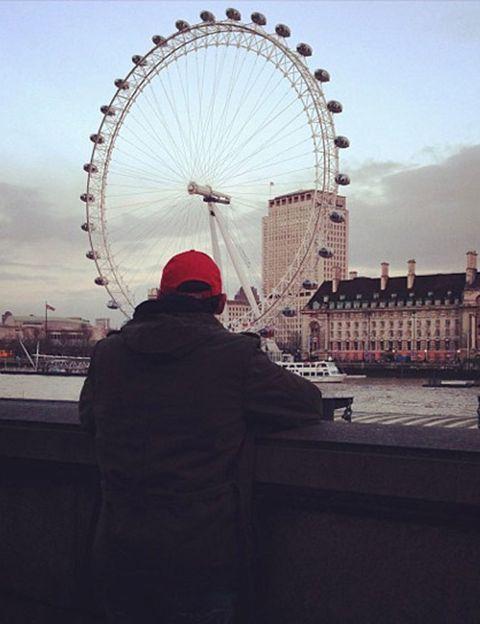 Ferris wheel, Daytime, Photograph, Urban area, Metropolis, Landmark, Tourism, Amusement ride, World, Sunlight,