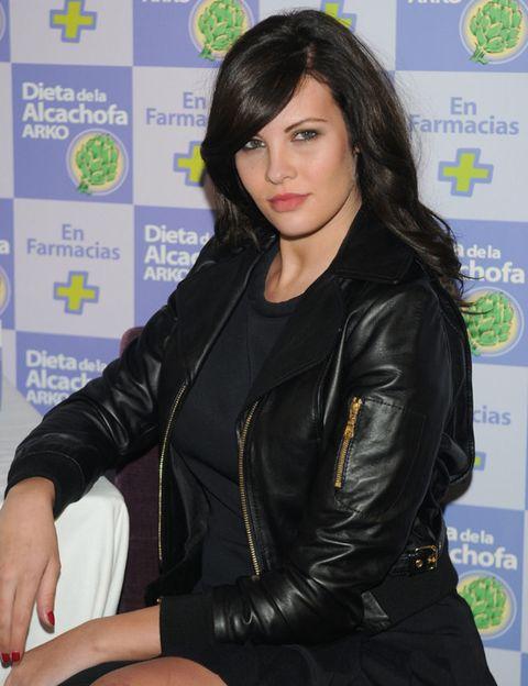 Jacket, Textile, Outerwear, Leather, Leather jacket, Logo, Black hair, Long hair, Zipper, Top,