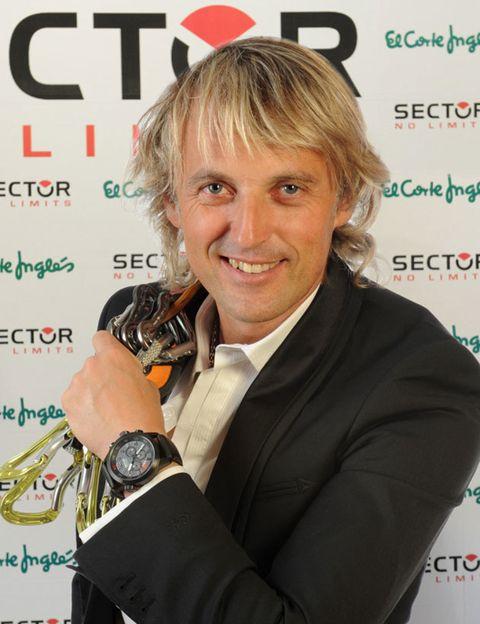 Style, Wrist, Suit, Watch, String instrument, Music artist, Blazer, Blond, Bracelet, Brown hair,