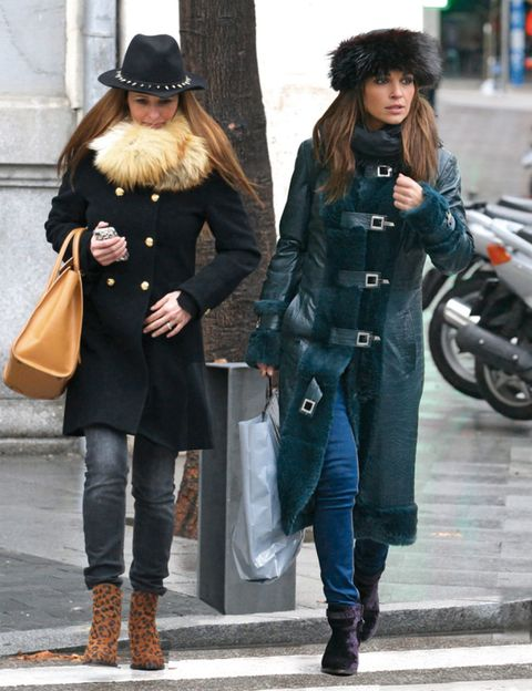 Clothing, Trousers, Hat, Winter, Textile, Coat, Outerwear, Motorcycle, Street fashion, Boot,