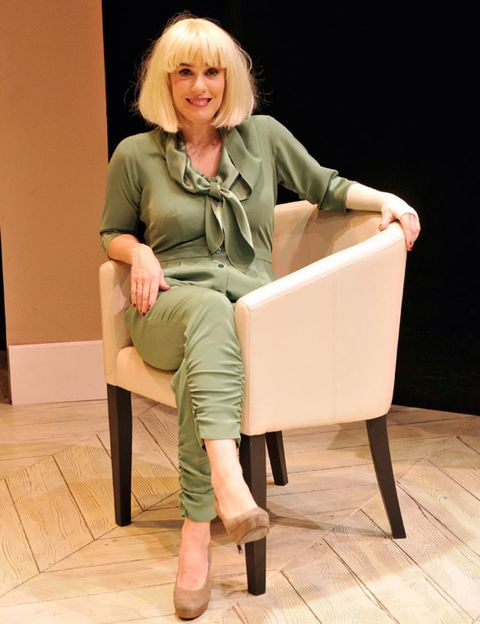 Joint, Sitting, Knee, Blond, Beige, Boot, Blazer, Necklace, Layered hair, Suit trousers,
