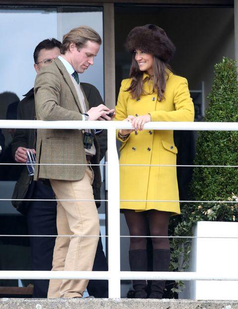 Coat, Trousers, Outerwear, Suit trousers, Blazer, Conversation, Pantsuit, Fence, Handbag, Pocket,