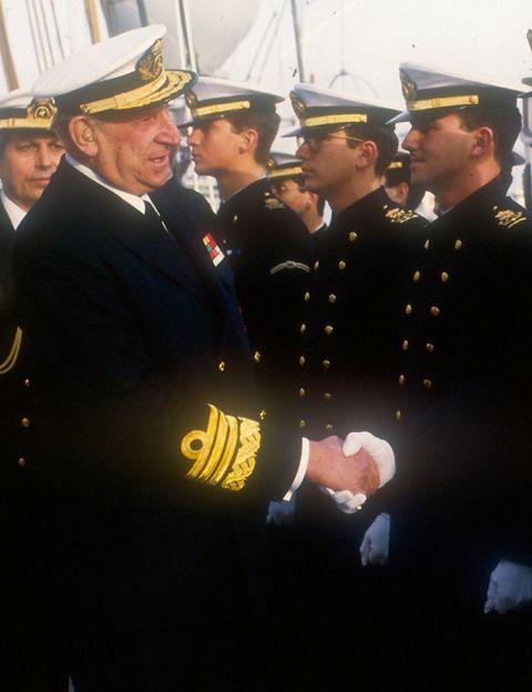 Military person, Soldier, Cap, Military uniform, Uniform, Military organization, Hat, Collar, Military, Headgear,