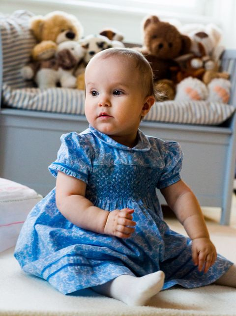Blue, Cheek, Brown, Stuffed toy, Textile, Toy, Sitting, Child, Baby & toddler clothing, Dress,