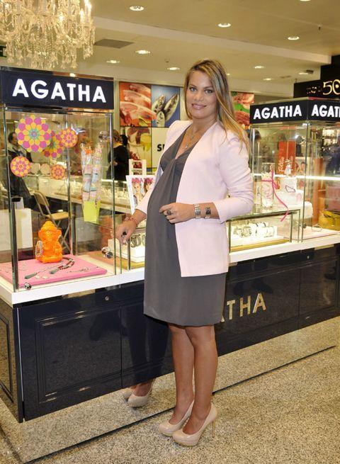 Coat, Retail, Logo, Street fashion, Display case, Foot, Blond, Makeover, Customer, Sandal,