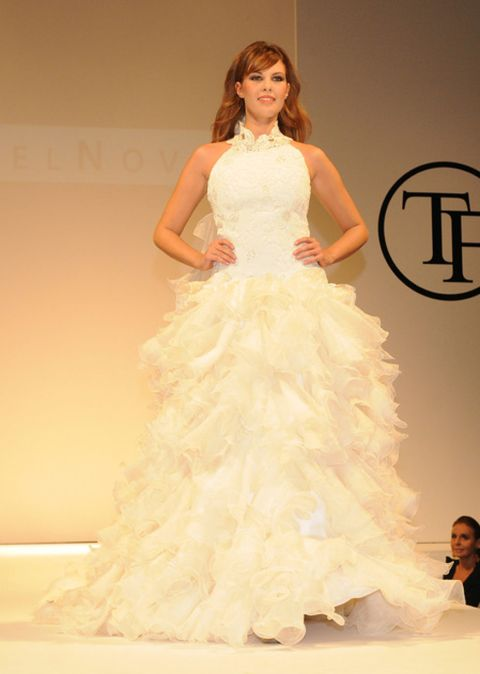 Face, Hairstyle, Shoulder, Gown, Fashion show, Style, Dress, Fashion model, Formal wear, Waist,