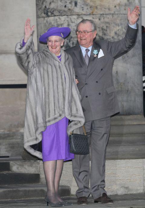 Footwear, Trousers, Hat, Shirt, Standing, Coat, Dress shirt, Suit trousers, Style, Purple,