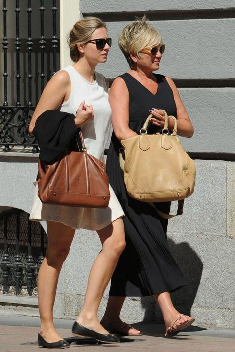 Clothing, Eyewear, Brown, Shoulder, Bag, Outerwear, Sunglasses, Fashion accessory, Style, Street fashion,