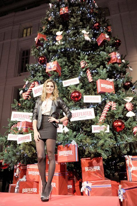 Event, Red, Christmas decoration, Christmas tree, Interior design, Holiday, Christmas ornament, Winter, Holiday ornament, Fashion,