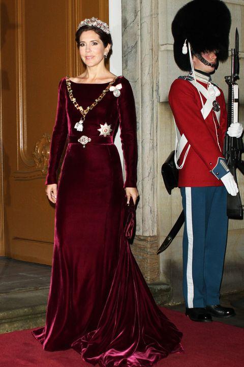 Bearskin, Red, Textile, Dress, Formal wear, Style, Gown, Flooring, Headgear, Fashion,