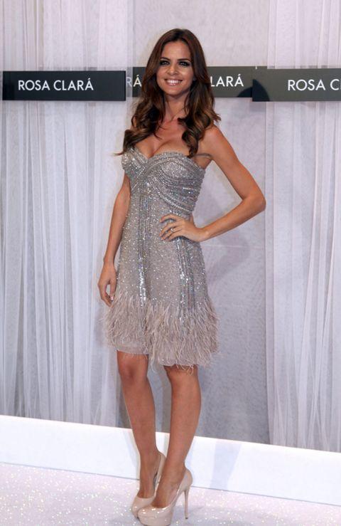 Clothing, Dress, Human body, Shoulder, Human leg, Joint, Fashion model, High heels, Fashion show, Style,