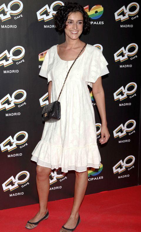 Clothing, Dress, Flooring, Shoulder, Shoe, Premiere, Style, Logo, Carpet, Cocktail dress,