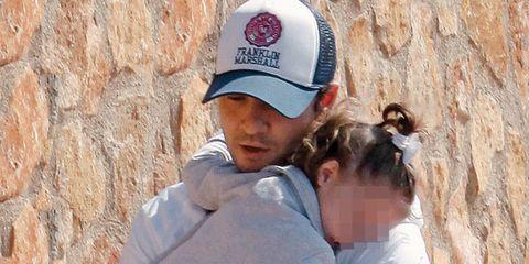 Cap, Baseball cap, T-shirt, Interaction, Headgear, Cricket cap, Love, Back, Trucker hat, Bonnet,