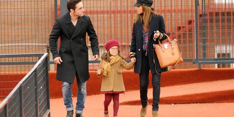 Footwear, Leg, Trousers, Coat, Outerwear, Jacket, Bag, Street fashion, Fashion accessory, Interaction,