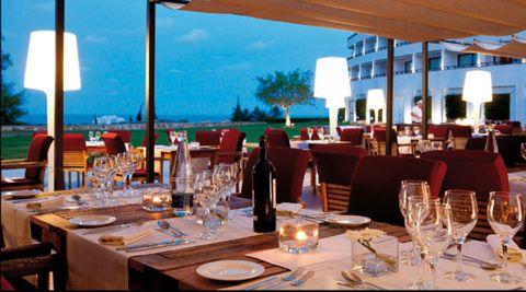 Drinkware, Glass, Stemware, Barware, Furniture, Tableware, Wine glass, Dishware, Table, Restaurant,