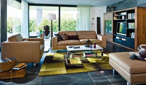 Room, Interior design, Brown, Floor, Living room, Home, Flooring, Wall, Furniture, Table,