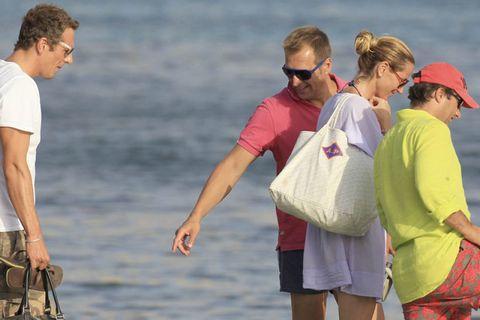 Eyewear, Cap, People in nature, Baseball cap, Sunglasses, board short, Travel, People on beach, Bag, Bermuda shorts,