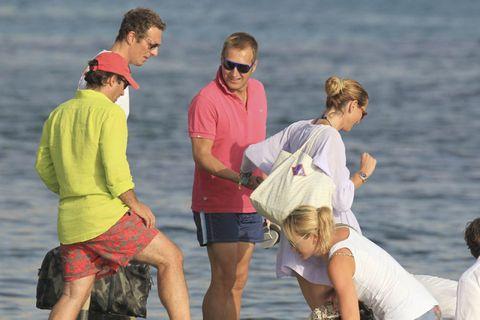 Eyewear, Sunglasses, Tourism, Interaction, Goggles, Bermuda shorts, Conversation, Back, Active shorts, People on beach,