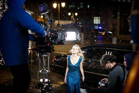 Video camera, Camera, Dress, Night, Electric blue, Television crew, Cobalt blue, Videographer, Camera operator, Film camera,