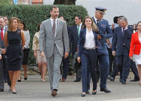 Clothing, Footwear, Coat, Dress shirt, Trousers, Collar, Shirt, Outerwear, Suit, Suit trousers,