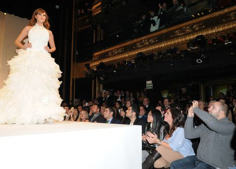 Face, Dress, Formal wear, Gown, Bridal clothing, Audience, Wedding dress, Fashion, Bride, Crowd,