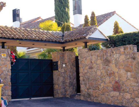 Roof, Door, House, Concrete, Residential area, Garage door, Stone wall, Garage, Gate, Driveway,