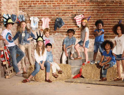 Leg, Social group, Jeans, Denim, Brick, Concrete, Brickwork, Sun hat, Playing with kids,
