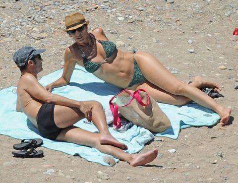 Eyewear, Leg, Fun, Hat, Human leg, Brassiere, Slipper, Summer, Sand, Sun tanning,