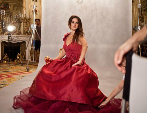 Dress, Hearth, Red, Formal wear, Gown, Flooring, One-piece garment, Fashion, Youth, Interior design,