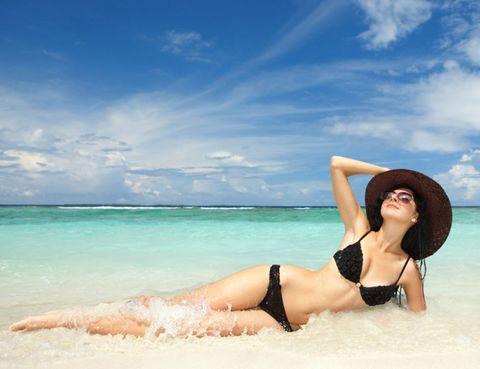 Body of water, Hairstyle, Skin, Brassiere, Swimwear, Human leg, Elbow, Summer, Hat, Swimsuit top,