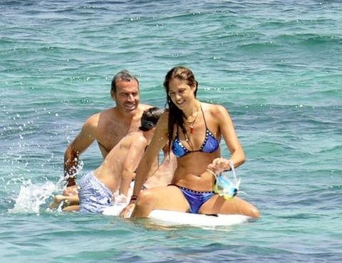 Clothing, Brassiere, Fun, Recreation, Water, Swimwear, Leisure, Swimsuit top, Chest, Bikini,
