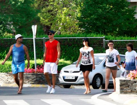 Clothing, Human, Leg, Human leg, Car, Shorts, Street fashion, Alloy wheel, Luxury vehicle, Mid-size car,