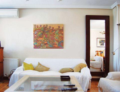 Room, Interior design, Wall, Pillow, Interior design, Linens, Orange, Home, Throw pillow, Door,