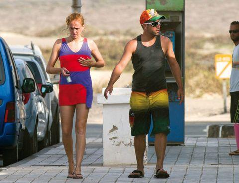 Leg, Human leg, Human body, Sleeveless shirt, Shorts, Cap, Waist, Electric blue, Vehicle door, Calf,