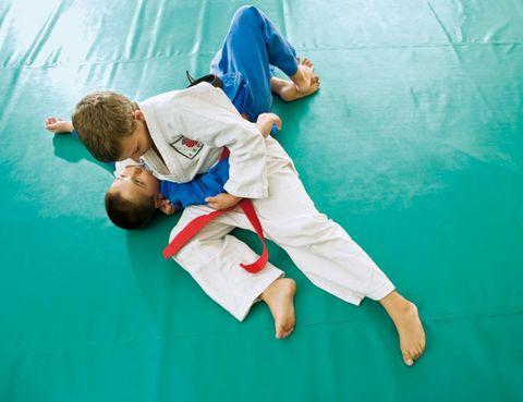 Blue, Sports uniform, Elbow, Hand, Joint, Martial arts uniform, Martial arts, Uniform, Contact sport, Combat sport,