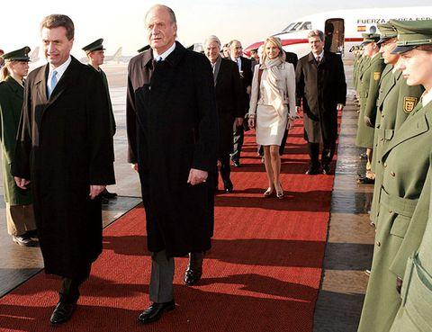 Footwear, Military person, Military uniform, Standing, Uniform, Formal wear, Hat, Flooring, Collar, Cap,