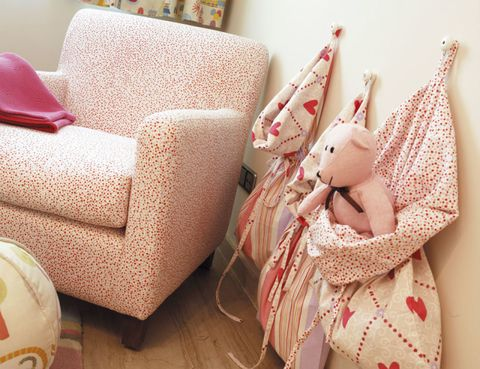 Doll, Toy, Peach, Club chair, Armrest, Living room, Fawn, Couch, Ball, Throw pillow,