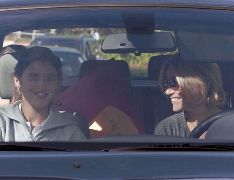 Motor vehicle, Mouth, Automotive design, Car seat, Vehicle door, Head restraint, Glass, Car seat cover, Automotive mirror, Automotive window part,