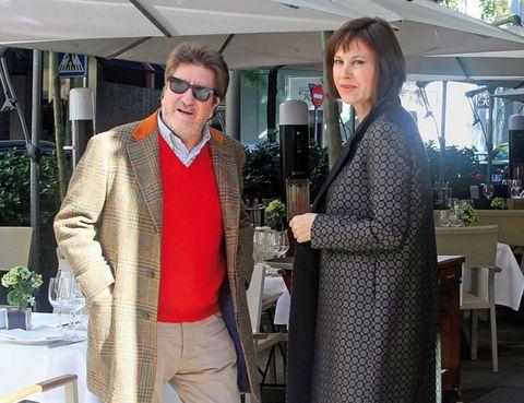 Trousers, Sunglasses, Outerwear, Standing, Coat, Flowerpot, Blazer, Goggles, Suit trousers, Houseplant,